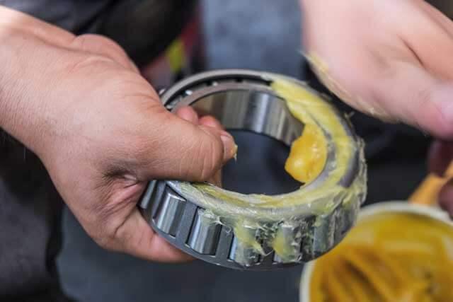applying grease on bearings
