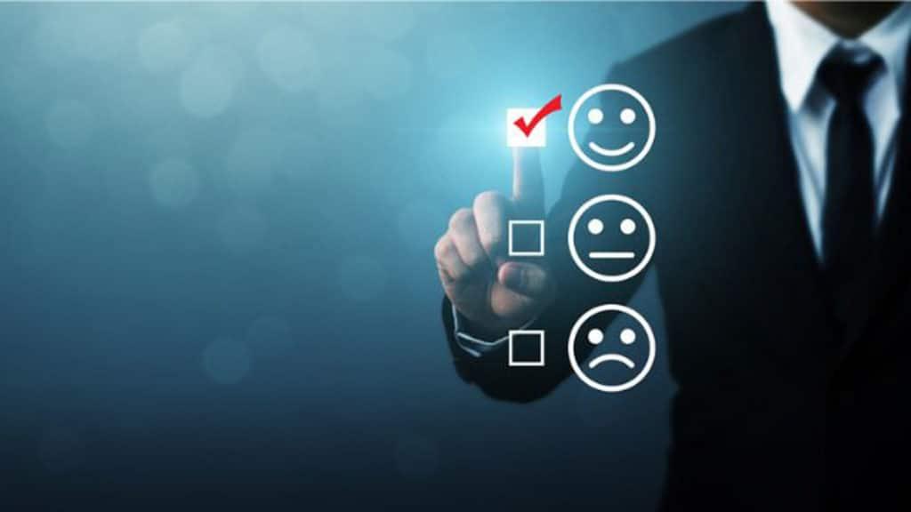 A person selecting a happy emoji